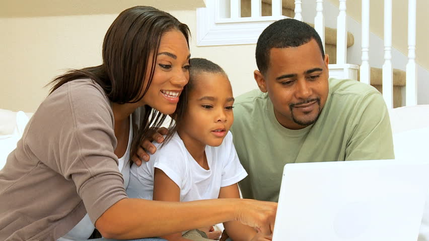 A family filing their taxes on a computer