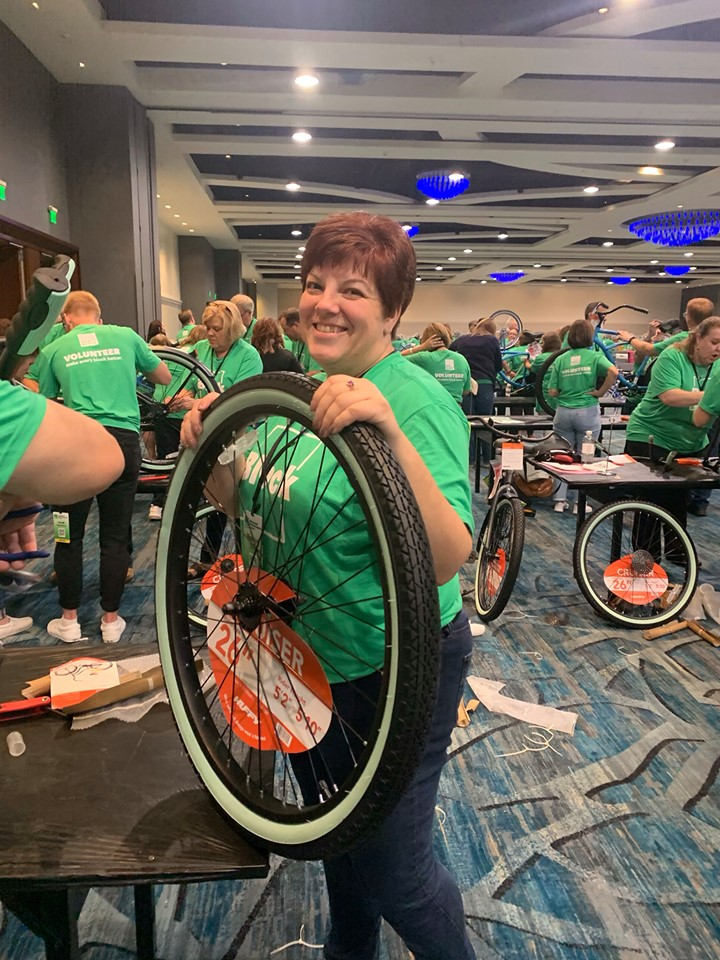 An HR Block employee building a bike a Heart of Florida United Way's Bike Build